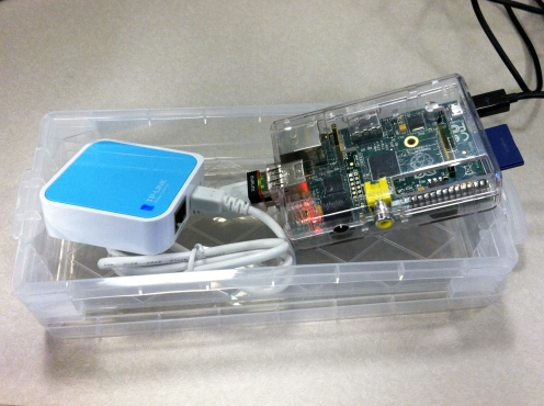 The Raspberry Pi and Router both fit in a Small Container for Travel